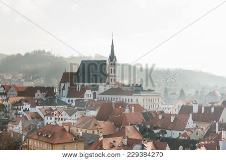 City View Of The Houses And The Church Of St. Vitus In Cesky Krumlov In The Czech Republic. The Chur