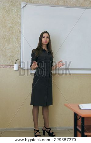 Lecture. Lesson. Young Teacher Or Student Reading A Lecture On White Blackboard Background With Copy