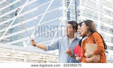 Teen Asia People Use Smart Phone To Selfie, Self-portrait Photography Shoot, Held In The Hand And Su