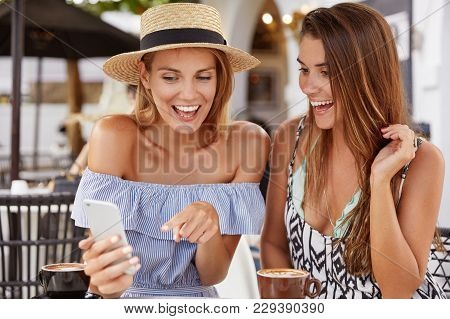 Positive Happy Women Have Summer Vacations, Glad To See Special Offer For Tourist On Internet Websit