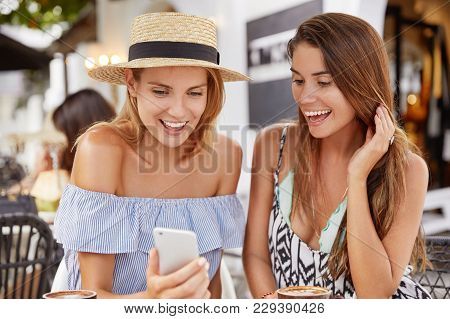 Beautiful Cheerful Female Best Friends Meet Together To Share Impressions About Summer Holidays, Vie