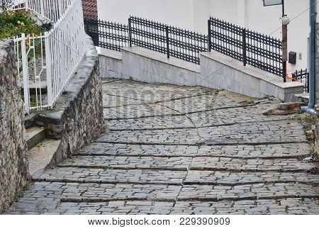 Detail Of A Small Pedestrian Street In Ohrid City Made Of Cobblestone
