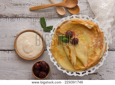 Stack Of Traditional Russian Pancakes  On Gray Background With Copy Space. Homemade Russian Thin Pan