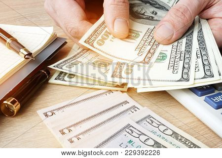Businessman Counting Us Dollars Bills. Small Business Concept.