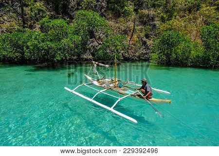 Coron, Philippines - Apr 10, 2017. A Man Sitting On Boat In Coron Island, Philippines. Coron Is A We