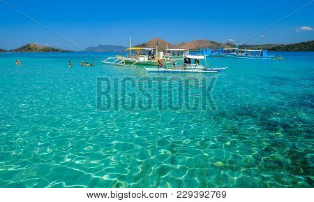 Coron, Philippines - Apr 10, 2017. Boats On Blue Sea In Coron Island, Philippines. Coron Is A Wedge-