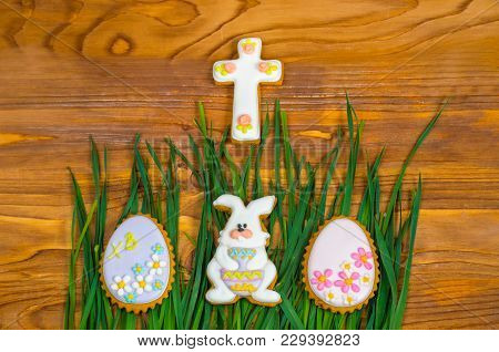 Easter Cookies. Little Bunny And Easter Eggs On Green Grass