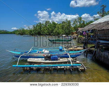 Coron, Philippines - Apr 10, 2017. Small Boats At Jetty In Coron Island, Philippines. Coron Is A Wed