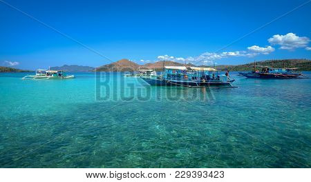 Coron, Philippines - Apr 10, 2017. Tourist Boats On Sea In Coron Island, Philippines. Coron Is A Wed