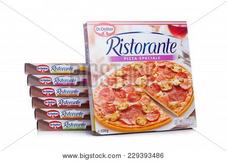London, Uk - March 01, 2018: Boxes Of Dr.oetker Pizza Speciale On White Background With Reflection.