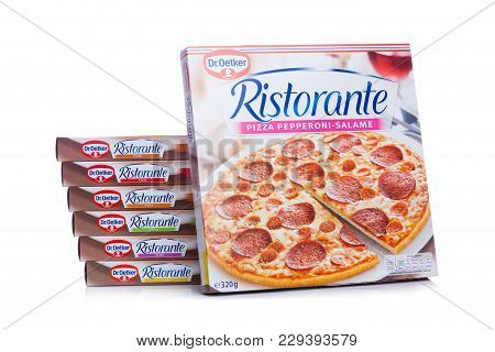 London, Uk - March 01, 2018: Boxes Of Dr.oetker Pizza Pepperoni-salame On White Background With Refl