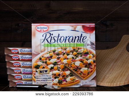 London, Uk - March 01, 2018: Boxes Of Dr.oetker Pizza Verdure On Wooden Background With Board And Cu
