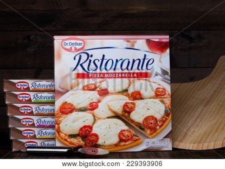 London, Uk - March 01, 2018: Boxes Of Dr.oetker Pizza Mozzarella On Wooden Background With Board And