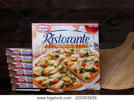 London, Uk - March 01, 2018: Boxes Of Dr.oetker Pizza Pollo On Wooden Background With Board And Cutt