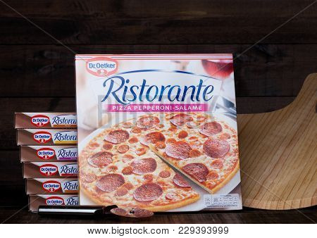 London, Uk - March 01, 2018: Boxes Of Dr.oetker Pizza Speciale On Wooden Background With Board And C