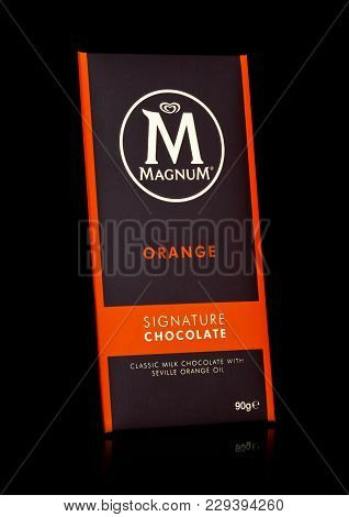London, Uk - March 01, 2018: Luxury Chocolate Bar Of Magnum Signature Chocolate With Orange On Black