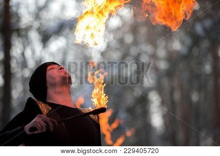 Belarus, Gomel, February 18, 2018. Russian Holiday Seeing Off Winter Maslenitsa.a Man Set Fire To Fi