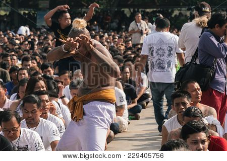 Bangkok, Thailand - March 2018: A Participant Of The Sak Yant Festival Is Falling In Trance