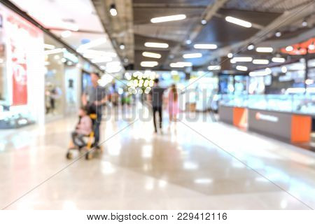 Blurred Of People Are Walking In Shopping Mall Or Department Store With Bokeh Background. Blurry Bac
