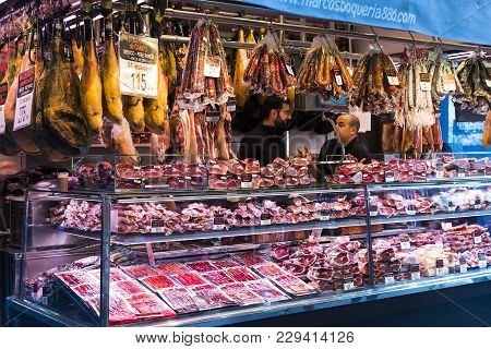 Barcelona, Spain - 11 January 2018: The Old Grocery Market Of Barcelona Boqueria Selling Food Jamon