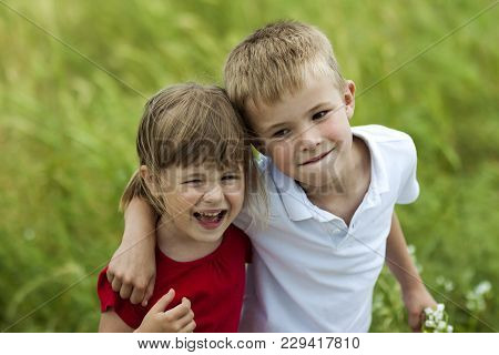 Young Boy And Girl Brother And Sister Together Laughing Happily