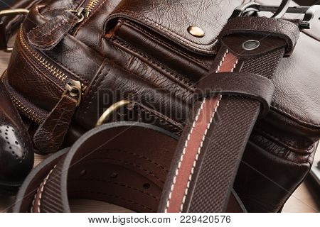 Close-up Men's Accessories, Brown Belt, Leather Briefcase And Shoes On Wooden Table.