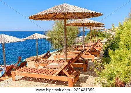 Zakynthos, Greece - October 1, 2017: Sunbeds And Umbrellas On Porto Limnionas Beach On Zakynthos Isl