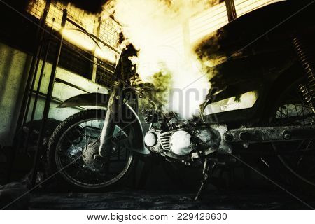 Closeup Abstract Background, Rusty Old Motorcycle Under Low Light With Noise, Grain And Smoke Effect