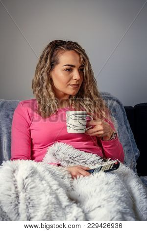 Beautiful Young Girl Watching Television Drink Coffee At Home