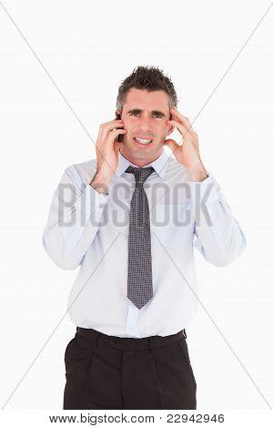 Portrait Of An Upset Man Making A Phone Call