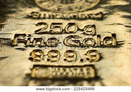 The Surface Of Cast Gold Bullion. Selective Focus. (shallow Dof)