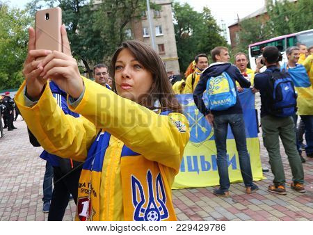 Kharkiv, Ukraine - September 2, 2017: Girl Makes A Selfie During Fan-march Of Ukrainian National Foo