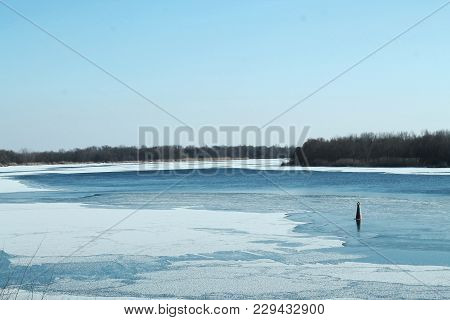 Landscape View Of The Winter River. The Frozen River. The Blue River. Ice And Winter.
