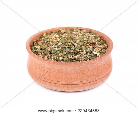 Mixed Italian Herbs Seasoning In A Wooden Bowl Isolated On White Background. Dried Herbs Seasoning,
