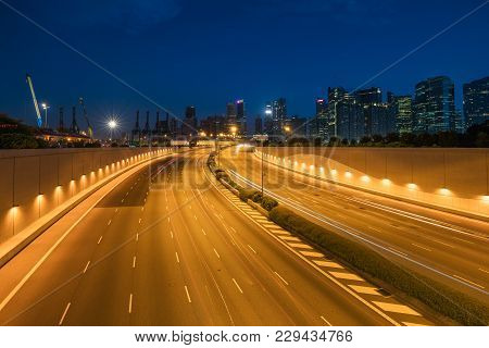 Singapore City, Marina Bay Finance And Trade Zone Of The Modern City In Night At Singapore. Asia