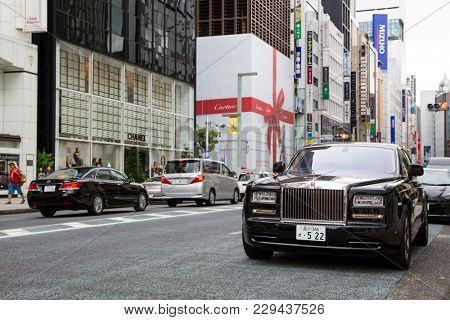 Tokyo, Japan - 24th June 2016: A black Rolls Royce Phantom on a street in Ginza, Tokyo. Ginza is the most  exclusive and expensive shopping district in Tokyo.