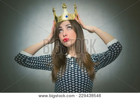 Selfish Woman. Arrogant Girl With High Self Esteem. Egoist Person Woman With Golden Crown On Her Hea