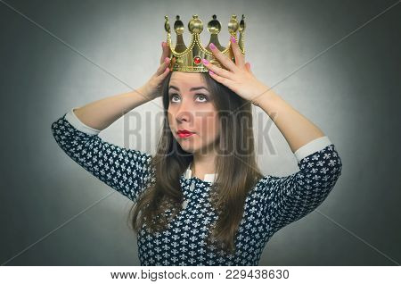 Happy Woman Is Holding In Hands A Golden Crown Above Her Head. Winner Concept. First Place. Authorit