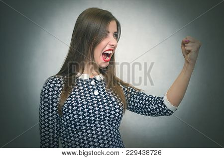 Angry Irritated Woman Is Shouting Isolated On Gray Background. Debates. Quarrel. Demanding Dissatisf