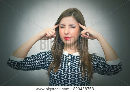 Pensive Woman Is Thinking And Try To Solve A Problem Isolated On Gray Background. Worried Woman. Dep