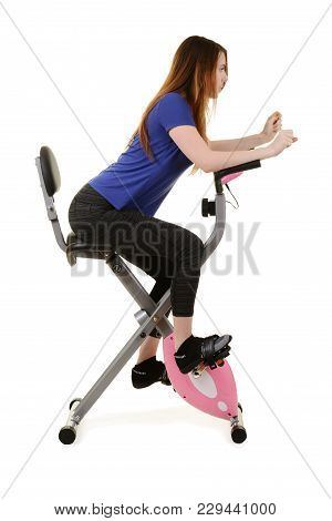 Young Woman Workout On An Exercise Bike