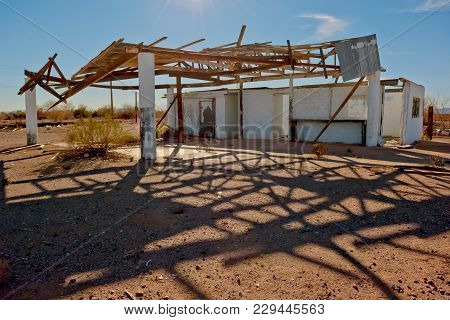 The Crumbling Remains Of An Abandoned Service Station Along Salome Road In Arizona Near The Settleme