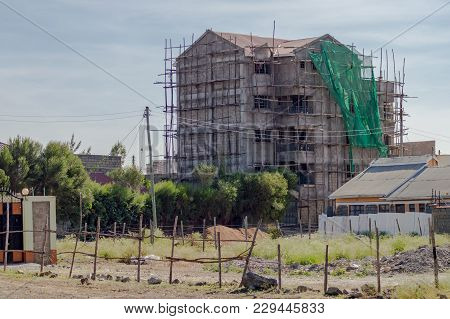 House Under Construction With A Wooden Scaffolding In The City Of Nairobi Kenya