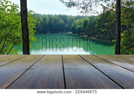 Wooden Boards With Landscape Of Forest Lake. Relaxing Holiday By The Lake. View From Wooden Bridge.