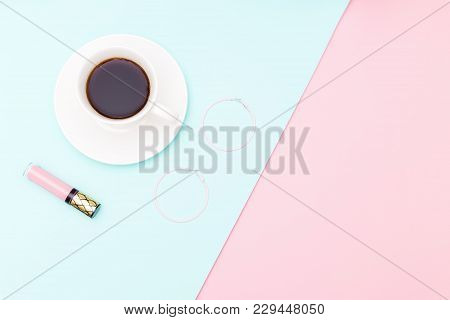 A Cup Of Coffee And Accessories On Pastel Background. Copy Space