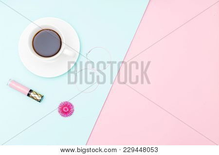 A Cup Of Coffee And Accessories On Pastel Background. Minimalist Design