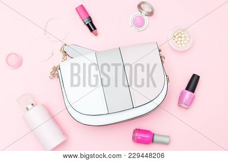 Handbag And Accessories On A Pink Background. Flat Lay