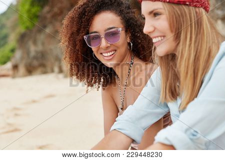 Lesbian Couple Or Close Young Female Friends Have Vacation On Tropical Beach, Look At Sunlight With