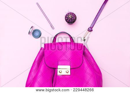 Handbag Purple Color And Accessories On A Pink Background. Flat Lay