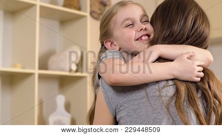 Happy Little Girl Smiling And Hugging Mother With Love, Warm Childhood Memories, Stock Footage